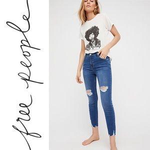 Shark bite skinny jeans